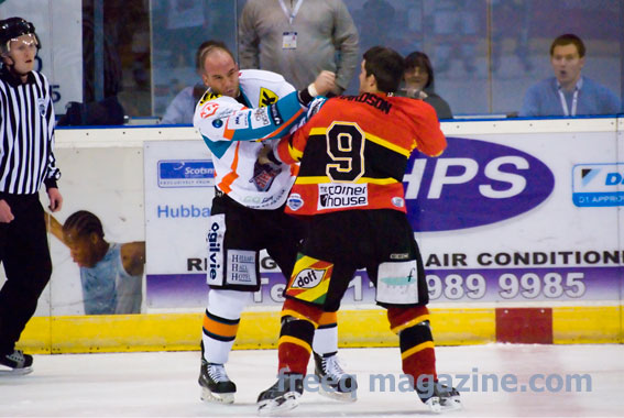 Nottingham Panthers Bruce Richardson fights Sheffield's Hewitt on a Boxing Day Ice Hockey game at the NIC
